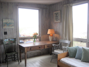 Large windows let in the view, sun, and salt sea air!