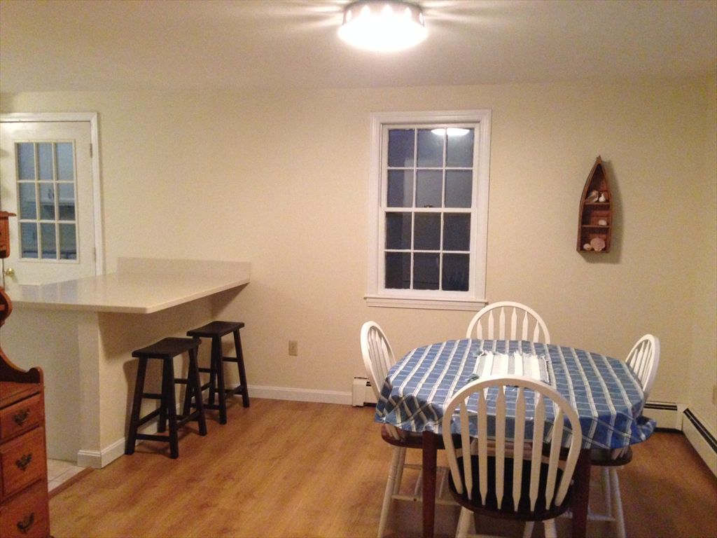 A look toward dining area from kitchen