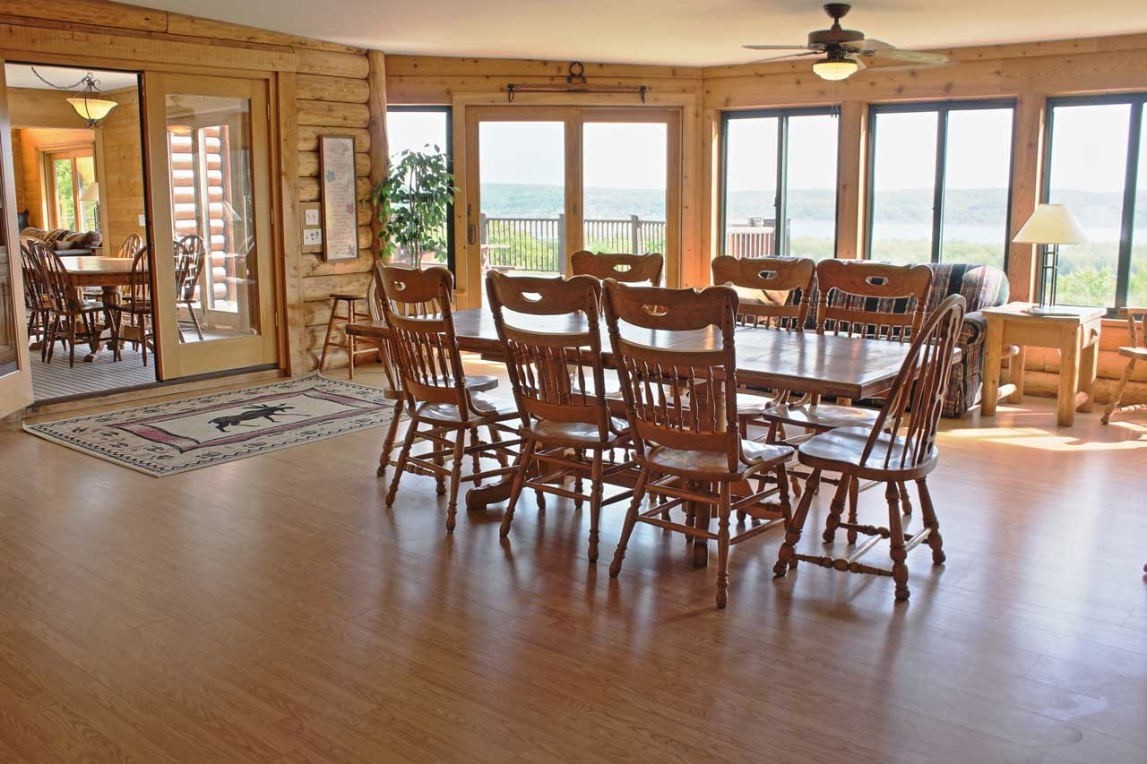 The main dining area has deck access and lake views
