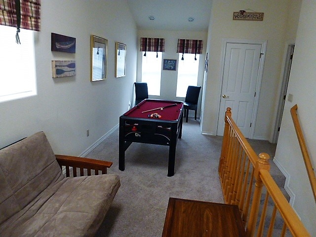 Loft /Gamerooom includes multi-game table, full size convertible futon and extra seating for all to enjoy.