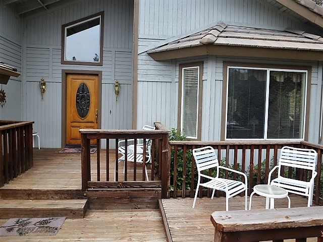 Inviting front deck welcomes all to sit, relax and enjoy the views.