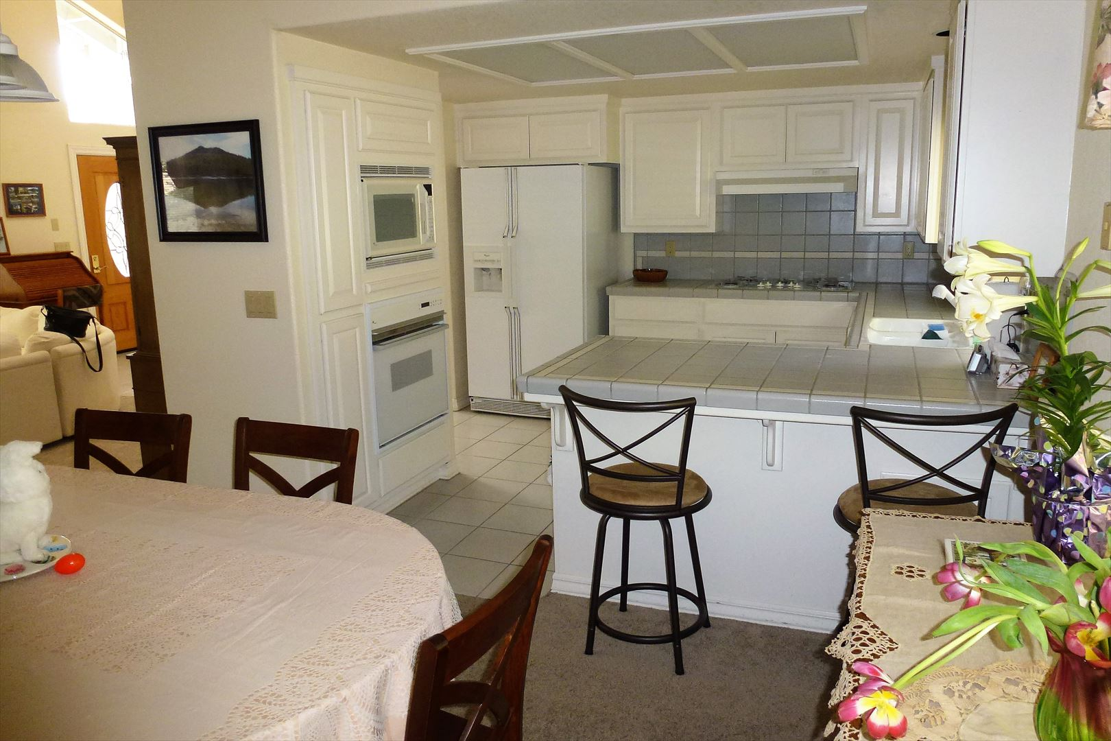 Kitchen is ideally located for all to gather and includes lots of working counter space.