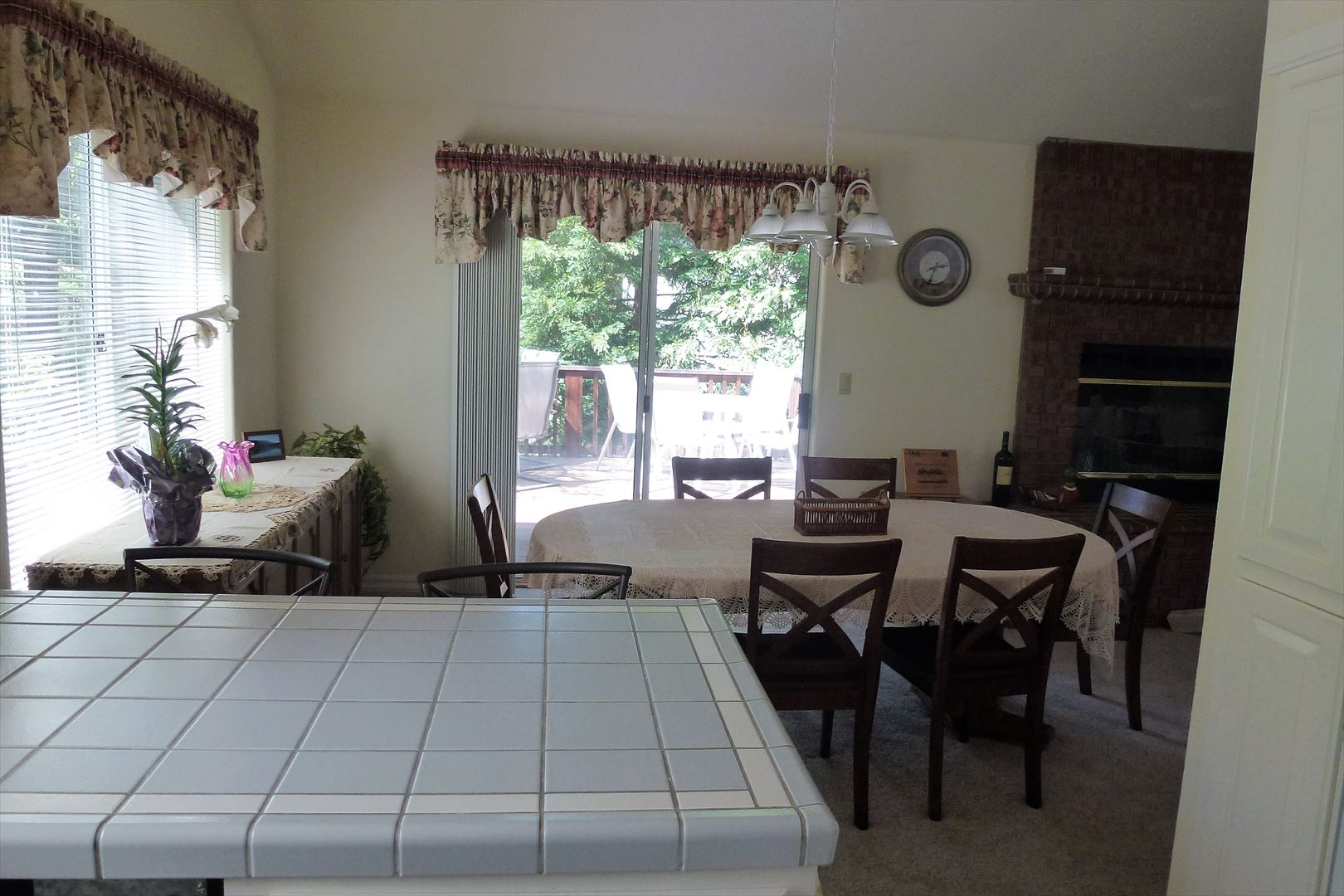 Kitchen has easy access through open dining area to the inviting outdoor side deck.