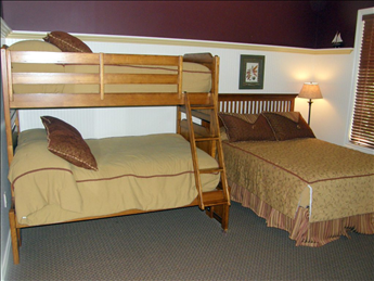 Second bedroom with queen and pyramid bed
