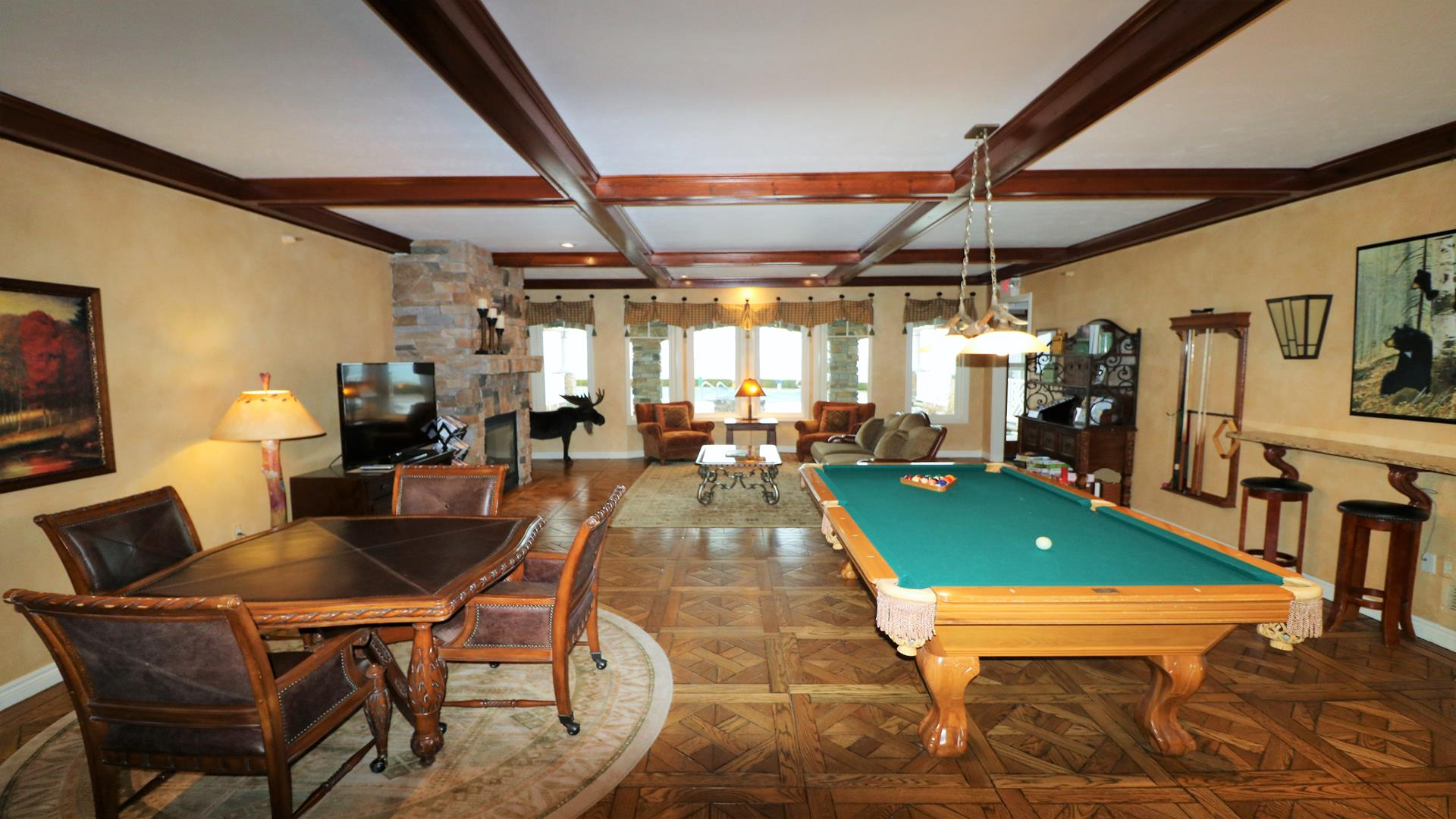 Clubhouse with kitchenette, billiard and pool tables