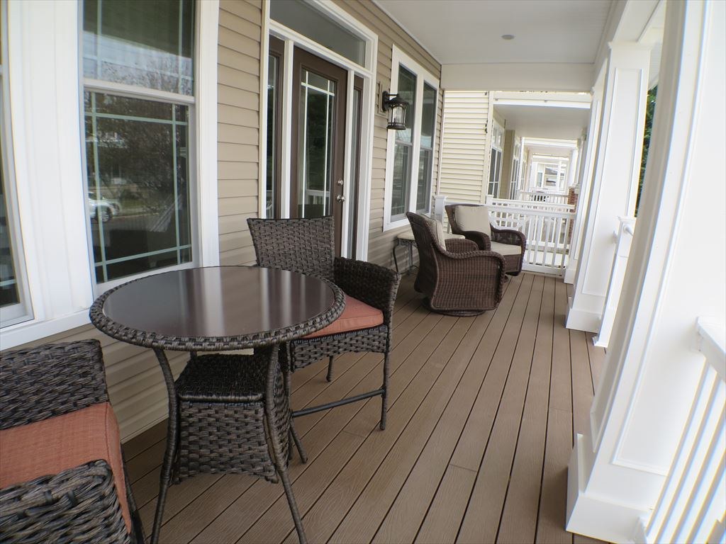 Front Porch - Two Swivel Rockers and High Top Table