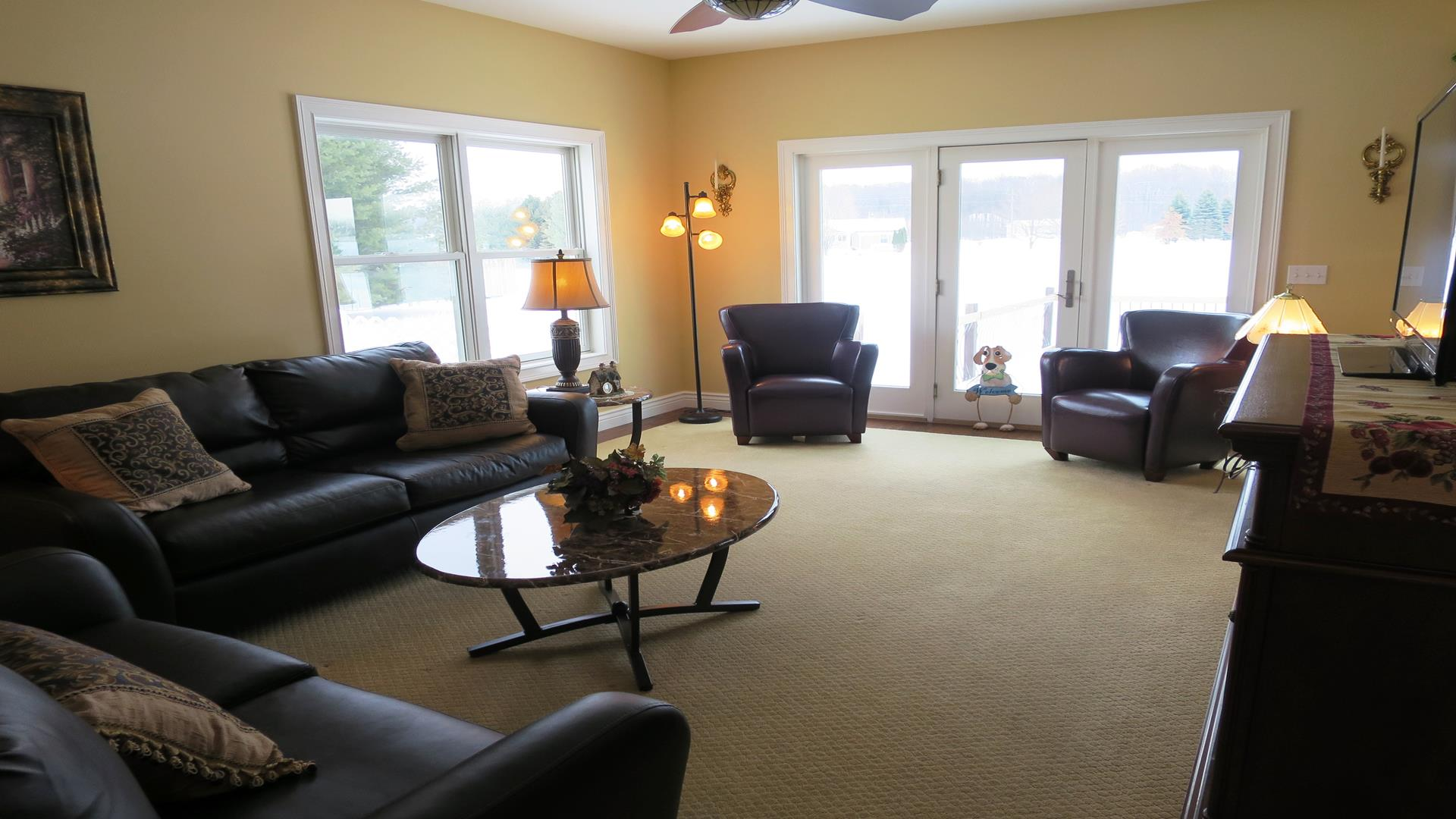 Main level family room with access to the back deck