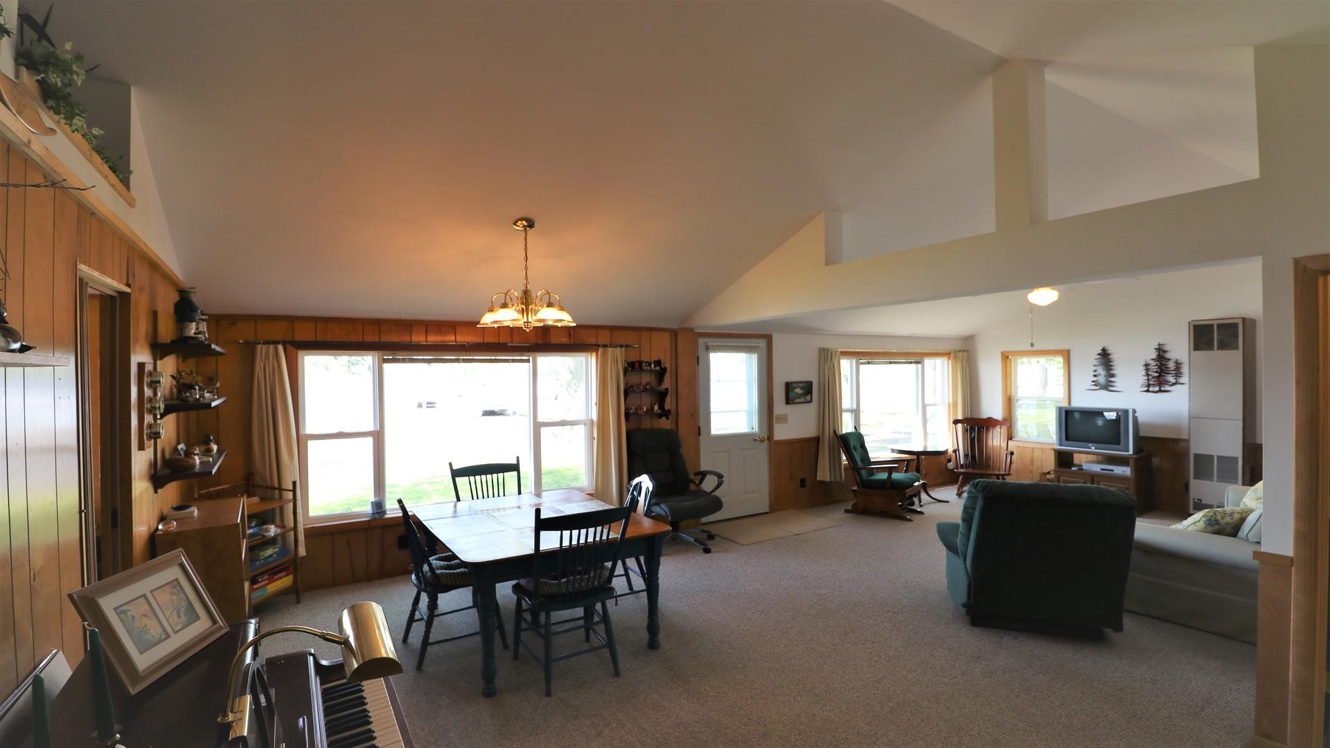 Open dining and living room with views of lake